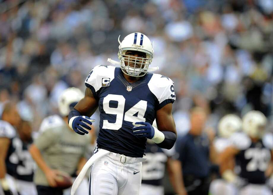 Dallas Cowboys outside linebacker DeMarcus Ware (94) jogs during warm ups before an NFL football game against the Washington Redskins Thursday, Nov. 22, 2012, in Arlington, Texas. (AP Photo/Matt Strasen) Photo: Matt Strasen, Associated Press / FR170476 AP