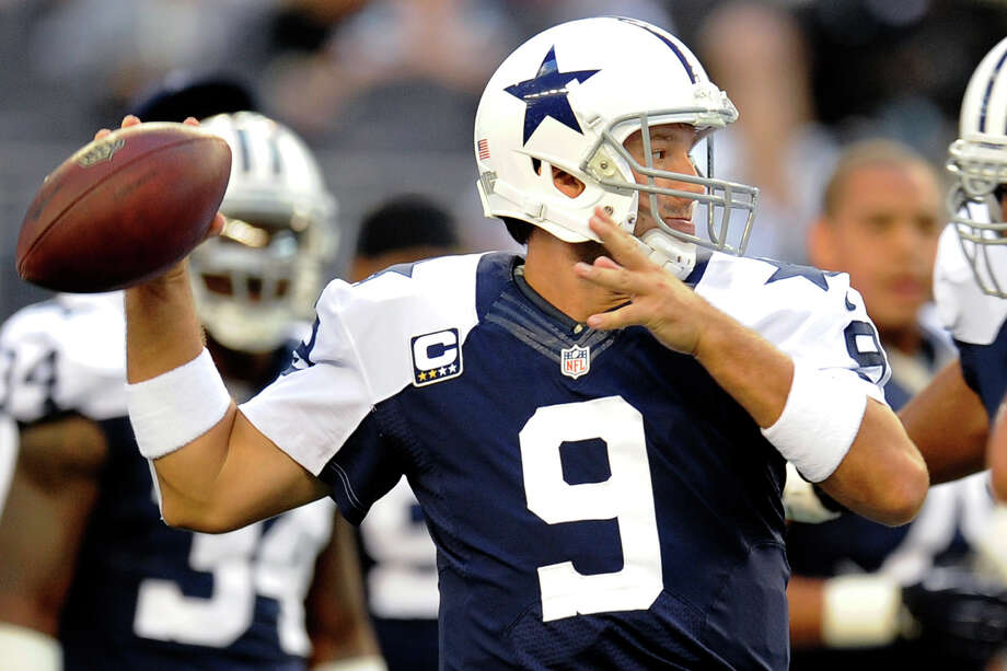 Dallas Cowboys quarterback Tony Romo (9) passes during warm ups before an NFL football game against the Washington Redskins, Thursday, Nov. 22, 2012, in Arlington, Texas. (AP Photo/Matt Strasen) Photo: Matt Strasen, Associated Press / FR170476 AP