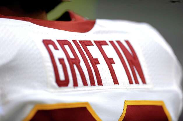 Washington Redskins' Robert Griffin III (10) stands on the field during warm ups before an NFL football game against the Dallas Cowboys Thursday, Nov. 22, 2012 in Arlington, Texas. (AP Photo/Matt Strasen) Photo: Matt Strasen, Associated Press / FR170476 AP
