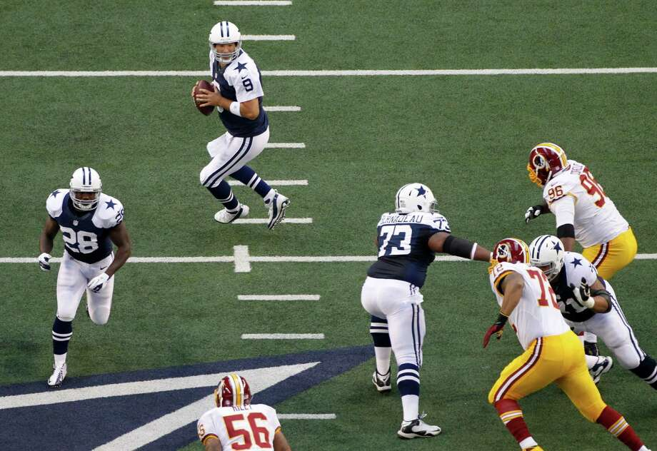 Dallas Cowboys quarterback Tony Romo (9) prepares to pass in the first half of an NFL football game against the Washington Redskins Thursday, Nov. 22, 2012, in Arlington, Texas. (AP Photo/Tim Sharp) Photo: Tim Sharp, Associated Press / FR62992 AP