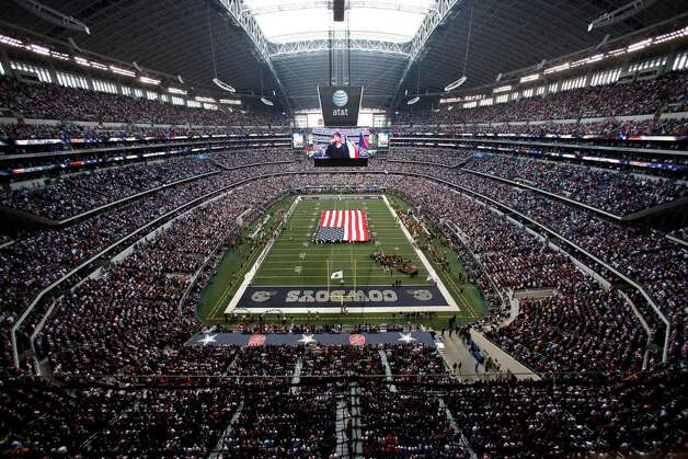 Cowboys stadium during the national anthem before an NFL football game against the Washington Redskins Thursday, Nov. 22, 2012, in Arlington, Texas. (AP Photo/Tim Sharp) Photo: Tim Sharp, Associated Press / FR62992 AP