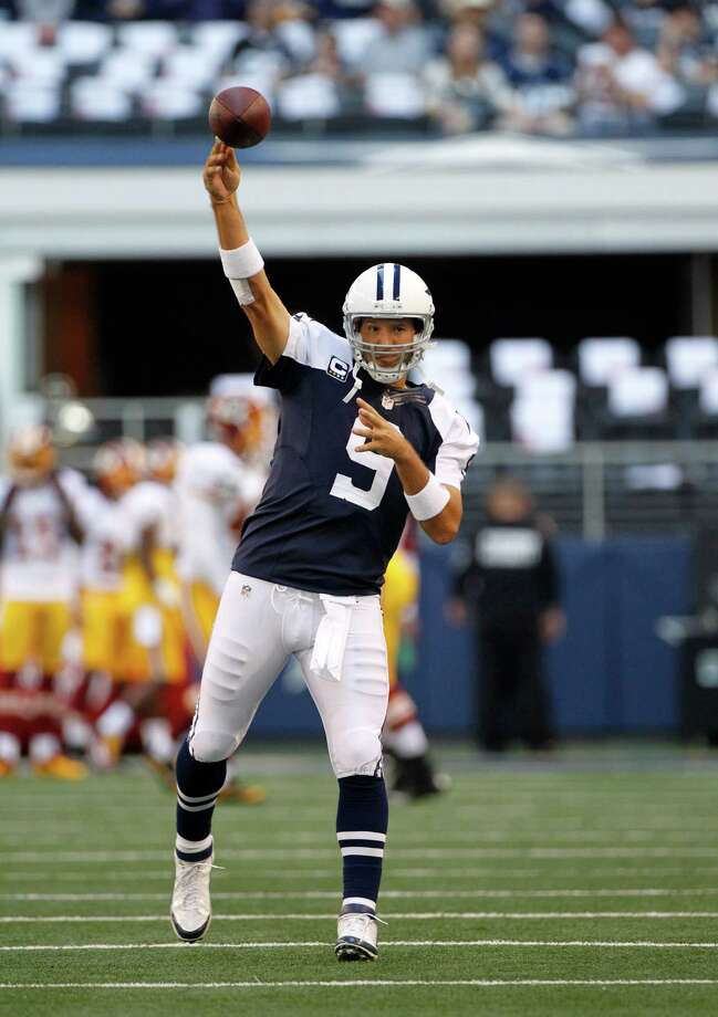 Dallas Cowboys quarterback Tony Romo (9) passes during warm ups before an NFL football game against the Washington Redskins Thursday, Nov. 22, 2012, in Arlington, Texas. (AP Photo/Tim Sharp) Photo: Tim Sharp, Associated Press / FR62992 AP