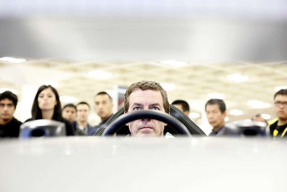 Kan Sandmann, of San Francisco, tries out the Ford Focus ST driving simulator at opening day at the 55th San Francisco International Auto Show in San Francisco, Calif., Thursday, November 22, 2012. Photo: Sarah Rice, Special To The Chronicle