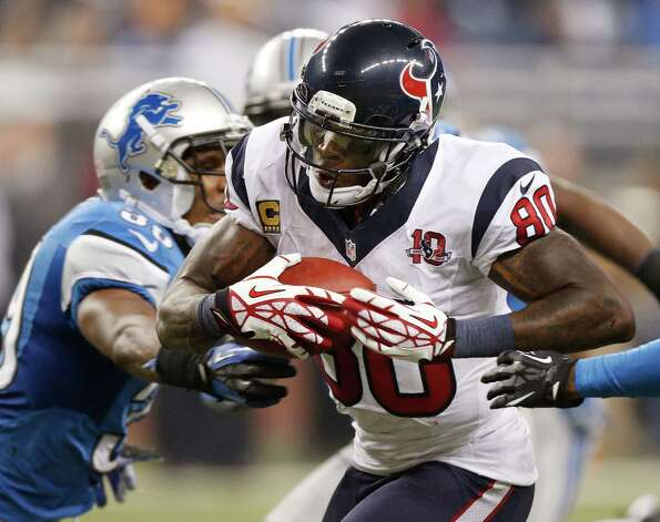Andre Johnson #80 of the Houston Texans tries to get around the tackle of Ricardo Silva #39 of the Detroit Lions after a overtime catch at Ford Field on November 22, 2012 in Detroit, Michigan. Houston won the game 34-31. Photo: Gregory Shamus, Getty Images / 2012 Getty Images