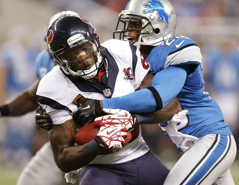 Andre Johnson #80 of the Houston Texans tries to get around the tackle of Chris Houston #23 of the Detroit Lions after a overtime catch at Ford Field on November 22, 2012 in Detroit, Michigan. Houston won the game 34-31. Photo: Gregory Shamus, Getty Images / 2012 Getty Images