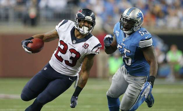 Arian Foster #23 of the Houston Texans runs for a first down as Stephen Tulloch #55 of the Detroit Lions gives chase during the game at Ford Field on November 22, 2012 in Detroit, Michigan. The Texans defeated the Lions 34-31. Photo: Leon Halip, Getty Images / 2012 Getty Images