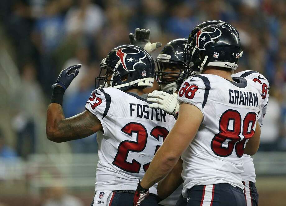 Arian Foster #23 of the Houston Texans celebrates with teammates after scoring on a one yard run in the third quarter during the game against the Detroit Lions at Ford Field on November 22, 2012 in Detroit, Michigan. The Texans defeated the Lions 34-31. Photo: Leon Halip, Getty Images / 2012 Getty Images