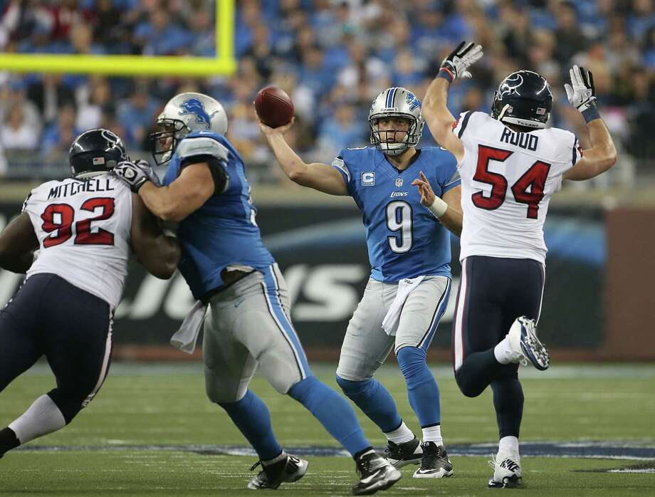 Matthew Stafford #9 of the Detroit Lions throws a pass as Barrett Ruud #54 of the Houston Texans attempts to block the pass during the game at Ford Field on November 22, 2012 in Detroit, Michigan. The Texans defeated the Lions 34-31. Photo: Leon Halip, Getty Images / 2012 Getty Images