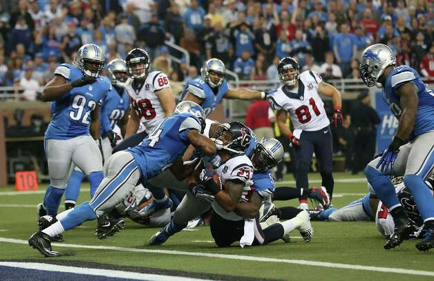 Arian Foster #23 of the Houston Texans runs for a short gain as Erik Coleman #24 of the Detroit Lions makes the stop during the fourth quarter of the game at Ford Field on November 22, 2012 in Detroit, Michigan. The Texans defeated the Lions 34-31. Photo: Leon Halip, Getty Images / 2012 Getty Images