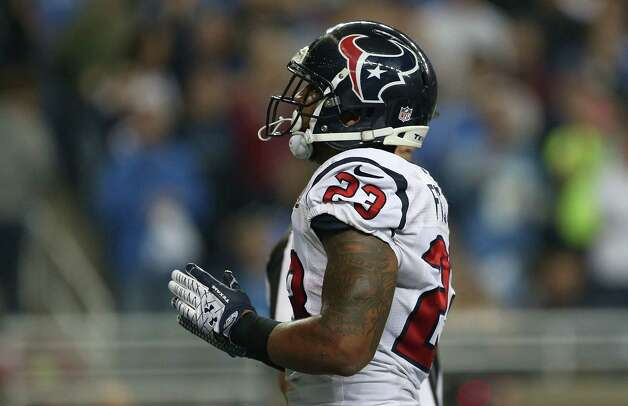 Arian Foster #23 of the Houston Texans celebrates after scoring on a one yard run in the third quarter during the game against the Detroit Lions at Ford Field on November 22, 2012 in Detroit, Michigan. The Texans defeated the Lions 34-31. Photo: Leon Halip, Getty Images / 2012 Getty Images