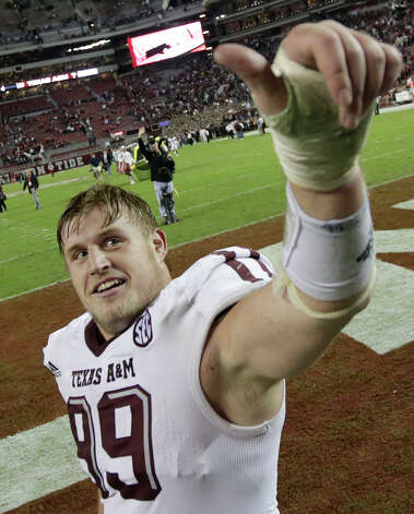 Texas A&M defensive lineman Spencer Nealy (99) reacts following a 29-24 win over Alabama during an NCAA college football game at Bryant-Denny Stadium in Tuscaloosa, Ala., Saturday, Nov. 10, 2012. (AP Photo/Dave Martin) Photo: Dave Martin, Associated Press / AP