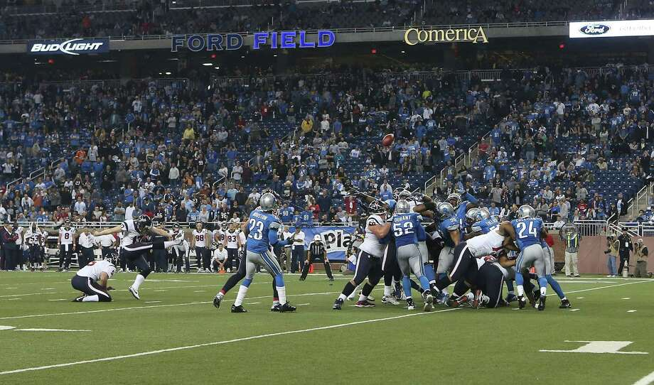 DETROIT, MI - NOVEMBER 22: Shayne Graham #17 of the Houston Texans kicks a 32-yard game-winning field goal in overtime to defeat the Detroit Lions at Ford Field on November 22, 2012 in Detroit, Michigan. The Texans defeated the Lions 34-31. Photo: Leon Halip, Getty Images / 2012 Getty Images