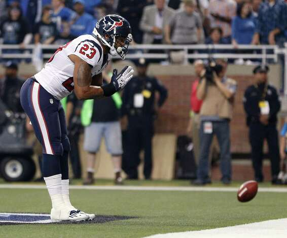 DETROIT, MI - NOVEMBER 22:  Arian Foster #23 of the Houston Texans celebrates a fourth quarter touchdown while playing the Detroit Lions during a Thanksgiving Day game at Ford Field on November 22, 2012 in Detroit, Michigan. Houston won the game 34-31. Photo: Gregory Shamus, Getty Images / 2012 Getty Images