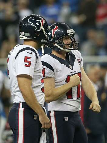DETROIT, MI - NOVEMBER 22:  Shayne Graham #17 of the Houston Texans celebrates kicking a 32-yard game-winning field goal in overtime to defeate the Detroit Lions with teammate Donnie Jones #5 at Ford Field on November 22, 2012 in Detroit, Michigan. The Texans defeated the Lions 34-31. Photo: Leon Halip, Getty Images / 2012 Getty Images