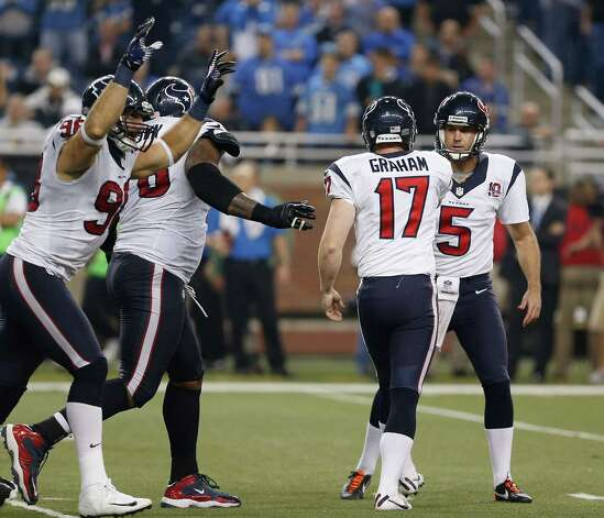 Shayne Graham #17 of the Houston Texans celebrates his overtime game winning field goal with Donnie Jones #5  to beat the Detroit Lions 34-31 at Ford Field on November 22, 2012 in Detroit, Michigan. Photo: Gregory Shamus, Getty Images / 2012 Getty Images