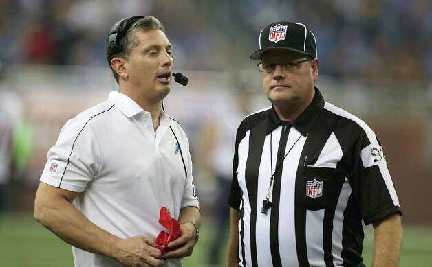 Detroit Lions head coach Jim Schwartz (L) talks with NFL official Jerry Bergman during a disputed play during the game against the Houston Texans at Ford Field on November 22, 2012 in Detroit, Michigan. The Texans defeated the Lions 34-31. Photo: Leon Halip, Getty Images / 2012 Getty Images