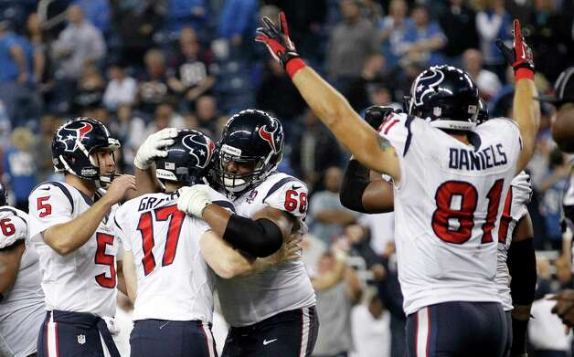 Houston Texans kicker Shayne Graham (17) is congratulated by Donnie Jones (5) and Ryan Harris (68) after kicking the game-winning field goal in overtime of an NFL football game against the Detroit Lions at Ford Field in Detroit, Thursday, Nov. 22, 2012. The Texans won 34-31. At right celebrating is Texans' Owen Daniels. (AP Photo/Rick Osentoski) Photo: Rick Osentoski, Associated Press / FR170444 AP