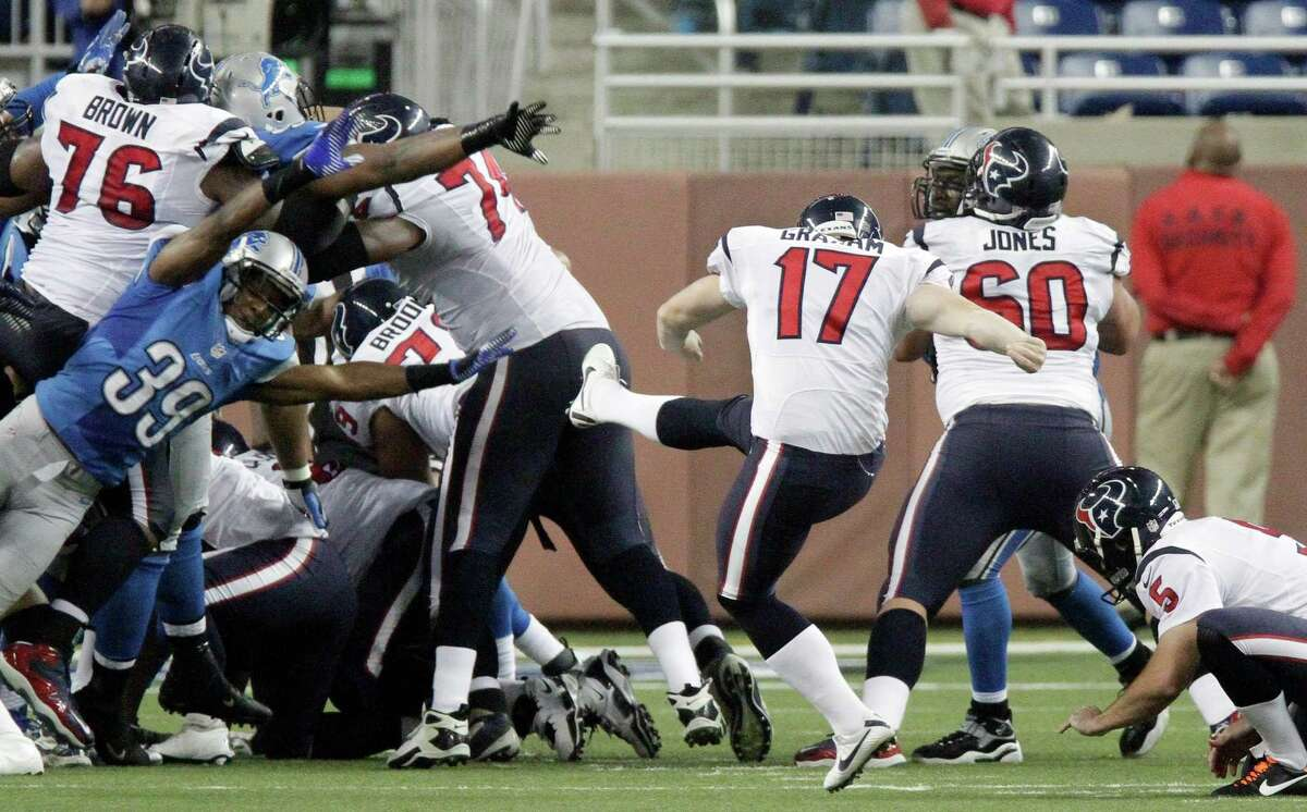 Houston Texans kicker Shayne Graham (17) kicks the game-winning field goal during overtime of an NFL football game against the Detroit Lions at Ford Field in Detroit, Thursday, Nov. 22, 2012. The Texans won 34-31. (AP Photo/Duane Burleson)