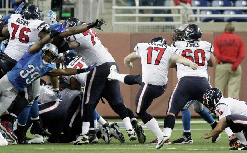 Houston Texans kicker Shayne Graham (17) kicks the game-winning field goal during overtime of an NFL football game against the Detroit Lions at Ford Field in Detroit, Thursday, Nov. 22, 2012. The Texans won 34-31. (AP Photo/Duane Burleson)