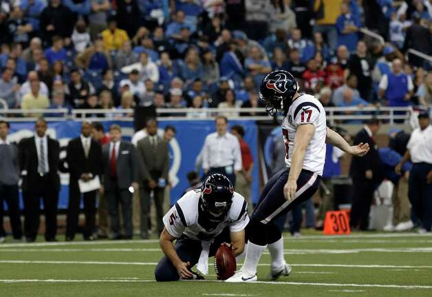 Houston Texans kicker Shayne Graham (17) kicks an extra point out of the hold of Donnie Jones (5) against the Detroit Lions in the second half of an NFL football game in Detroit, Thursday, Nov. 22, 2012. Houston won 34-31. (AP Photo/Paul Sancya) Photo: Paul Sancya, Associated Press / AP