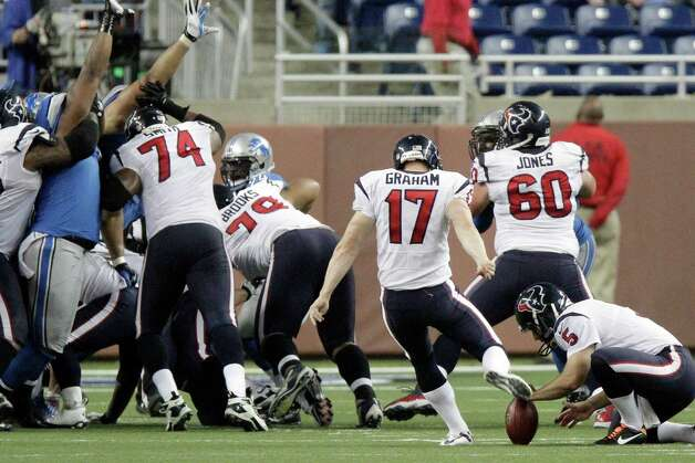 Houston Texans kicker Shayne Graham (17) kicks the game-winning field goal during overtime of an NFL football game against the Detroit Lions at Ford Field in Detroit, Thursday, Nov. 22, 2012. The Texasn won 34-31. (AP Photo/Duane Burleson) Photo: Duane Burleson, Associated Press / FR38952 AP