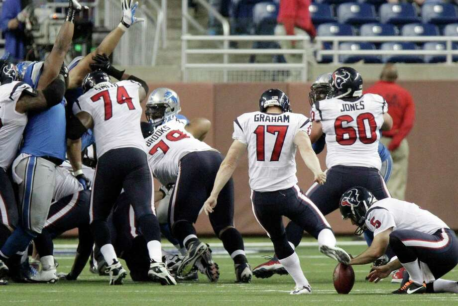 Houston Texans kicker Shayne Graham (17) kicks the game-winning field goal during overtime of an NFL football game against the Detroit Lions at Ford Field in Detroit, Thursday, Nov. 22, 2012. The Texasn won 34-31. (AP Photo/Duane Burleson) Photo: Duane Burleson, Associated Press / FR38952 AP