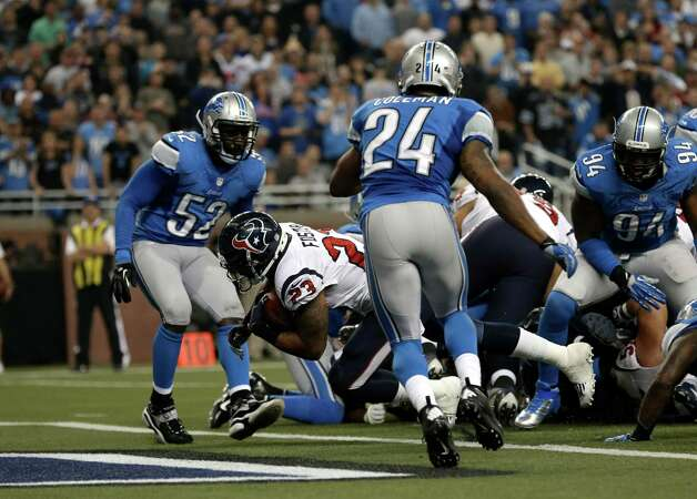 Houston Texans running back Arian Foster (23) scores on a 1-yard touchdown run against the Detroit Lions in the second half of an NFL football game in Detroit, Thursday, Nov. 22, 2012. Houston won 34-31. (AP Photo/Paul Sancya) Photo: Paul Sancya, Associated Press / AP