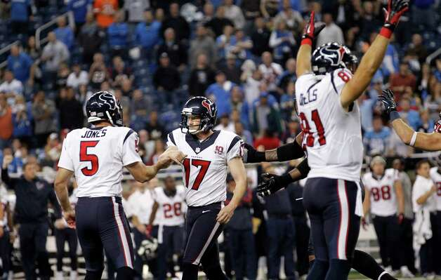 Houston Texans kicker Shayne Graham (17) is congratulated by Donnie Jones (5) after kicking the game-winning field goal in overtime of an NFL football game against the Detroit Lions at Ford Field in Detroit, Thursday, Nov. 22, 2012. The Texans won 34-31. At right celebrating is Texans' Owen Daniels. (AP Photo/Rick Osentoski) Photo: Rick Osentoski, Associated Press / FR170444 AP