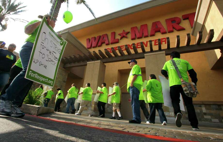 Several hundred Wal-Mart workers took part in a walkout and protest in front of the Pico Rivera, Calif., store on Oct. 4 - the first strike in the retailer's history. Photo: Mark Boster, MBR / Los Angeles Times
