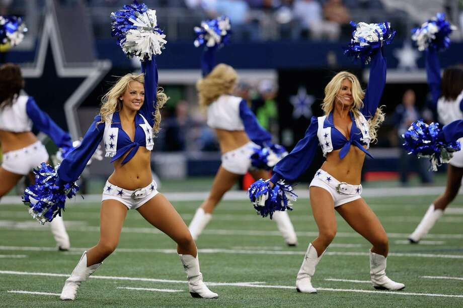 The Dallas Cowboys Cheerleaders perform before a Thanksgiving Day game between the Washington Redskins and the Dallas Cowboys at Cowboys Stadium on November 22, 2012 in Arlington, Texas. Photo: Ronald Martinez, Getty Images / 2012 Getty Images