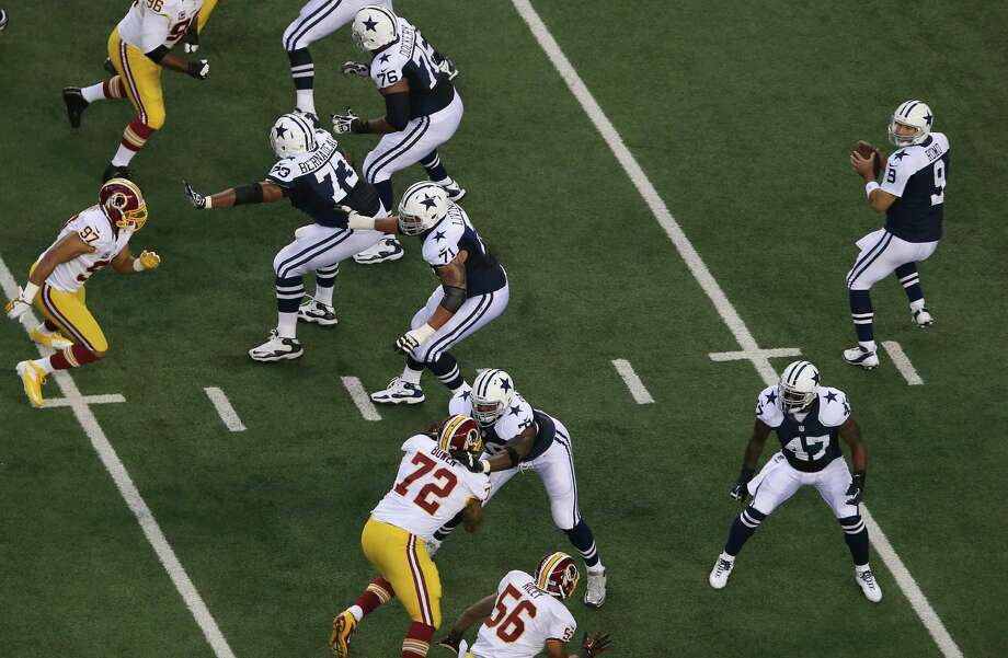 Tony Romo #9 of the Dallas Cowboys throws against the Washington Redskins during a Thanksgiving Day game at Cowboys Stadium on November 22, 2012 in Arlington, Texas. Photo: Ronald Martinez, Getty Images / 2012 Getty Images