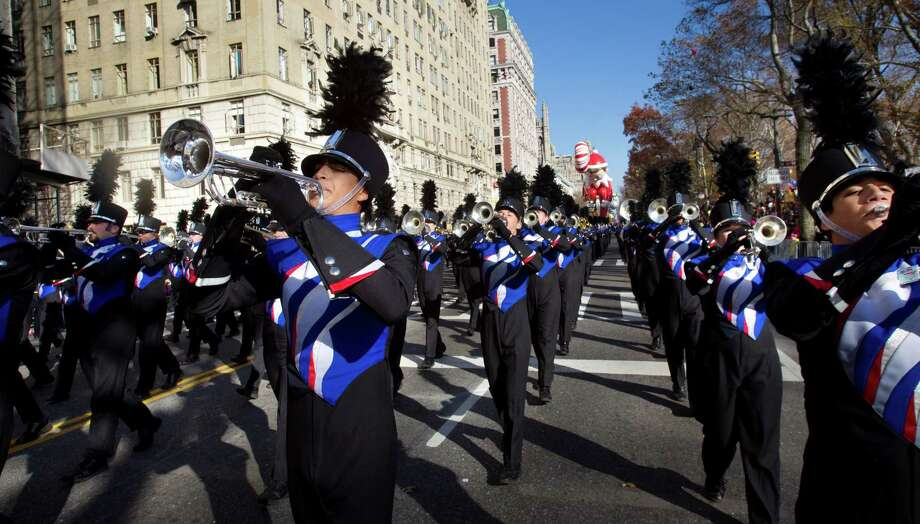 Conroe's Oak Ridge High School Marching band marches along Central Park West in New York on Thursday as part of the Macy's Thanksgiving Day parade. Photo: Brett Coomer, Houston Chronicle / © 2012 Houston Chronicle