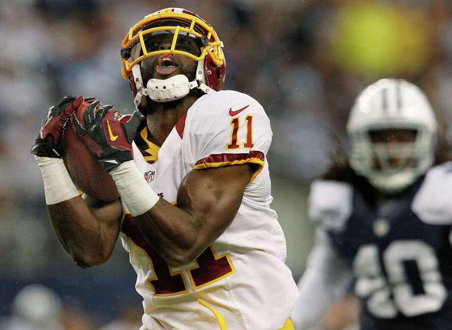 Aldrick Robinson #11 of the Washington Redskins pulls in a pass for a touchdown against Danny McCray #40 of the Dallas Cowboys on Thanksgiving Day at Cowboys Stadium on November 22, 2012 in Arlington, Texas. Photo: Tom Pennington, Getty Images / 2012 Getty Images