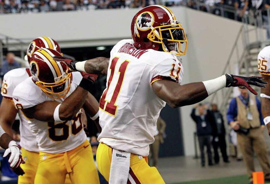 Aldrick Robinson #11 of the Washington Redskins celebrates with Pierre Garcon #88 of the Washington Redskins after scoring a touchdown the Dallas Cowboys on Thanksgiving Day at Cowboys Stadium on November 22, 2012 in Arlington, Texas. Photo: Tom Pennington, Getty Images / 2012 Getty Images