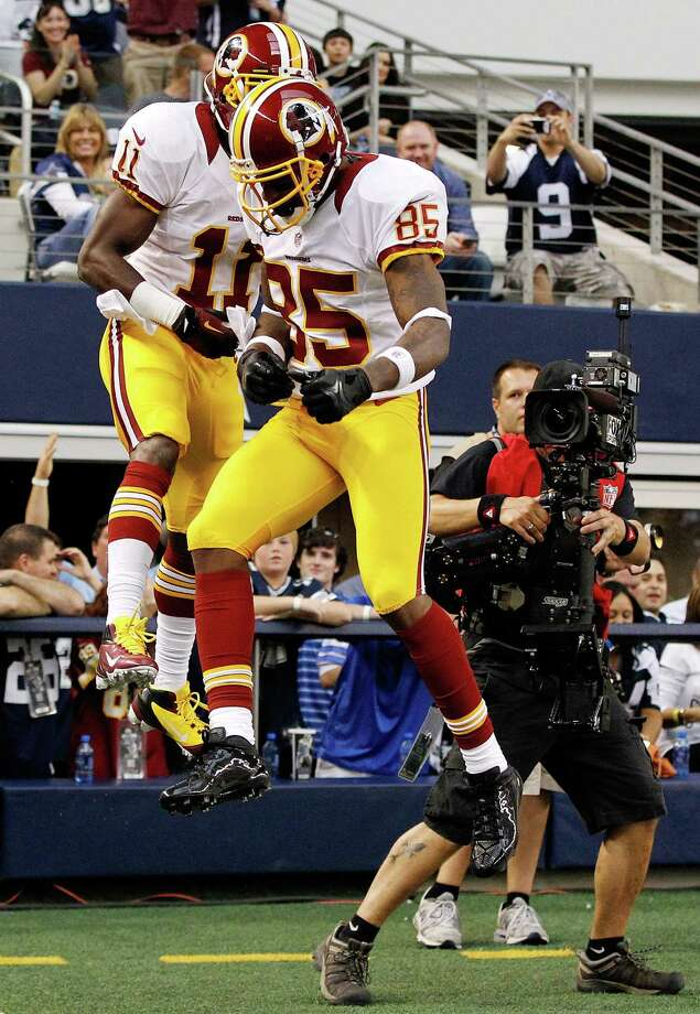 Aldrick Robinson #11 of the Washington Redskins celebrates with Leonard Hankerson #85 of the Washington Redskins after scoring a touchdown the Dallas Cowboys on Thanksgiving Day at Cowboys Stadium on November 22, 2012 in Arlington, Texas. Photo: Tom Pennington, Getty Images / 2012 Getty Images