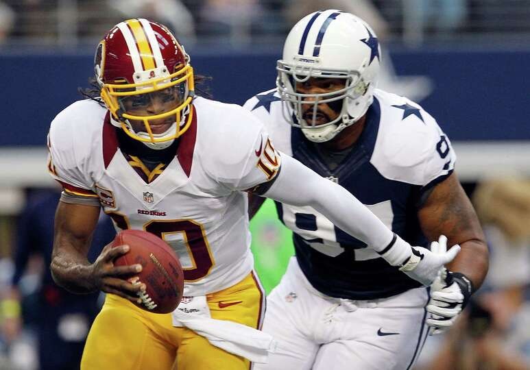 Robert Griffin III #10 of the Washington Redskins scrambles with the ball before being sacked by