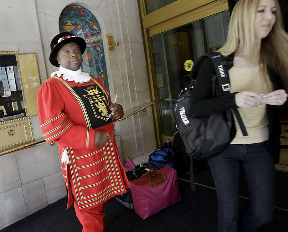 In his Beefeater uniform, doorman Laban Wade helps guests with directions at the Sir Francis Drake Hotel on Union Square on the holiday. Photo: Brant Ward, The Chronicle
