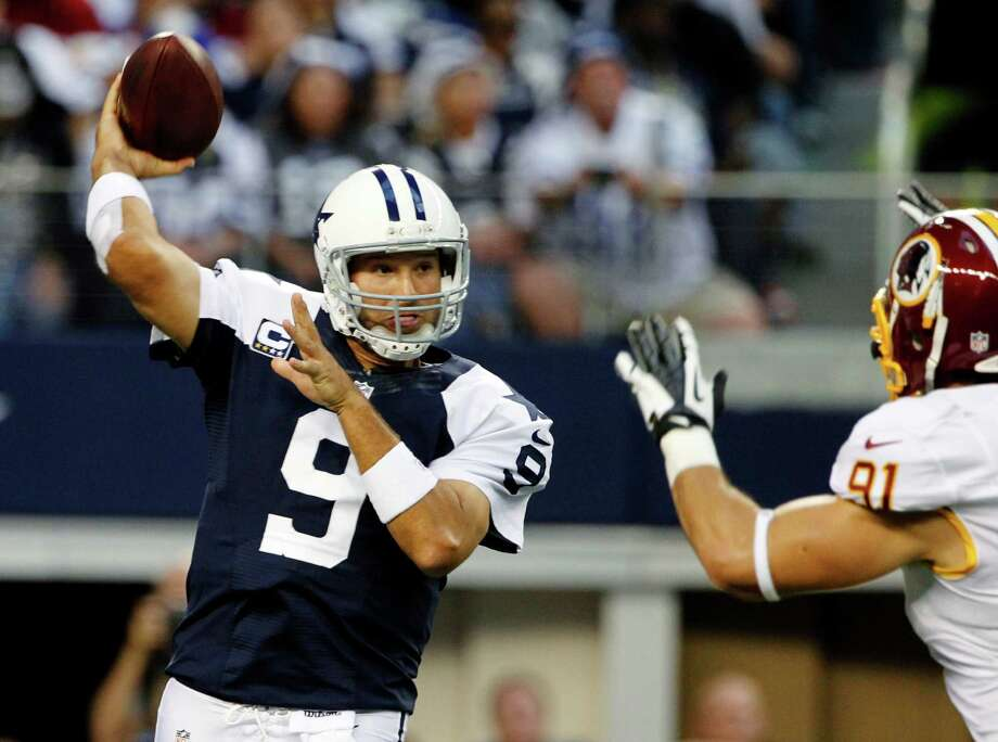 Dallas Cowboys quarterback Tony Romo (9) passes under pressure from Washington Redskins outside linebacker Ryan Kerrigan (91) in the first half of an NFL football game, Thursday, Nov. 22, 2012 in Arlington, Texas. (AP Photo/Tim Sharp) Photo: Tim Sharp, Associated Press / FR62992 AP