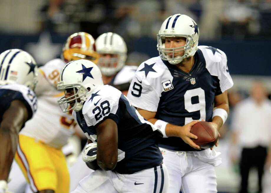Dallas Cowboys' Tony Romo (9) fakes a hand off to Felix Jones (28) in the first half of an NFL football game against the Washington Redskins Thursday, Nov. 22, 2012, in Arlington, Texas. (AP Photo/Matt Strasen) Photo: Matt Strasen, Associated Press / FR170476 AP