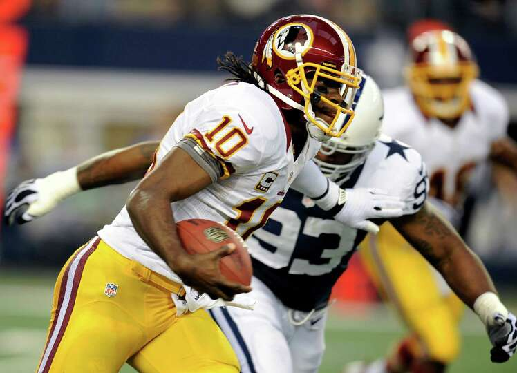 Washington Redskins quarterback Robert Griffin III (10) scrambles out of the pocket as Dallas Cowboy