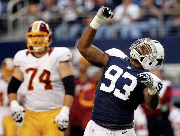 Dallas Cowboys' Anthony Spencer (93) celebrates sacking Washington Redskins quarterback Robert Griffin III, not pictured, as tackle Tyler Polumbus (74) watches in the first half of an NFL football game, Thursday, Nov. 22, 2012, in Arlington, Texas. (AP Photo/Tim Sharp) Photo: Tim Sharp, Associated Press / FR62992 AP
