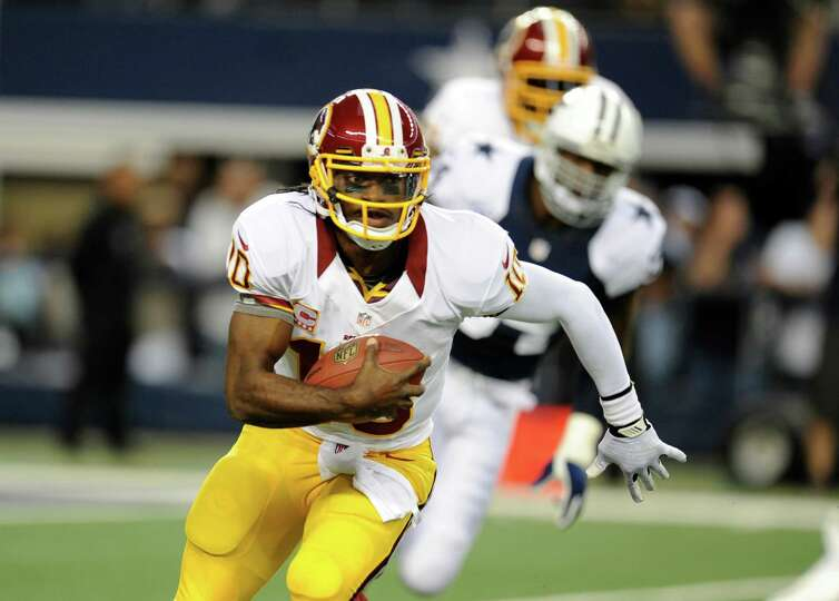 Washington Redskins quarterback Robert Griffin III (10) scrambles out of the pocket in the first hal