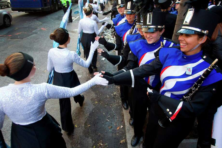 Members of the Oak Ridge High School Marching Band slap hands with the color guard from the Niceville, Fla., band, wishing them luck, before marching in the Macy's Thanksgiving Day Parade Thursday, Nov. 22, 2012, in New York City. Photo: Brett Coomer, Houston Chronicle / © 2012 Houston Chronicle