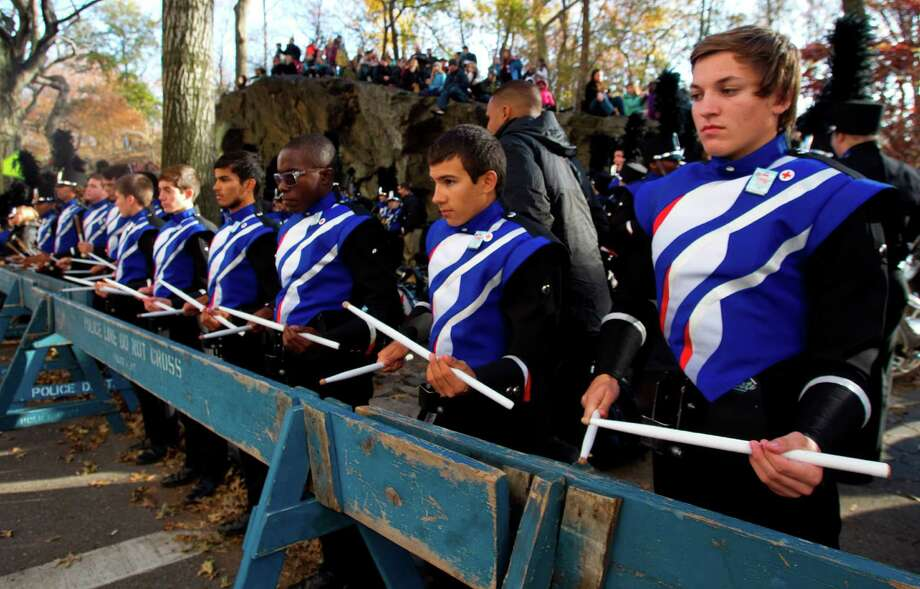 The Oak Ridge High School Marching Band's drum line play on a police line barricade while waiting on Central Park West to march in the Macy's Thanksgiving Day Parade Thursday, Nov. 22, 2012, in New York. City. Photo: Brett Coomer, Houston Chronicle / © 2012 Houston Chronicle