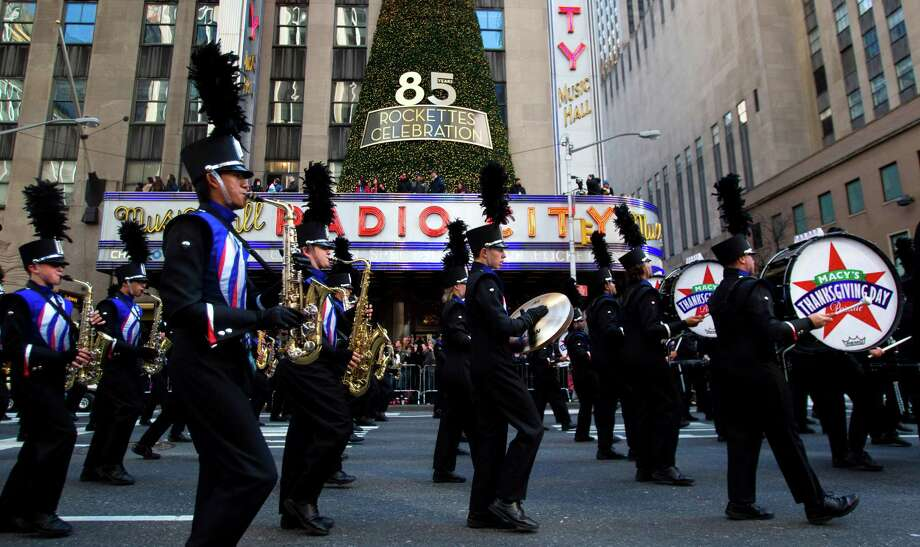 The Oak Ridge High School Marching Band performs as they march past Radio City Music Hall along 6th Avenue during the Macy's Thanksgiving Day Parade Thursday, Nov. 22, 2012, in New York City. Photo: Brett Coomer, Houston Chronicle / © 2012 Houston Chronicle