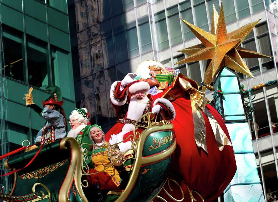 Santa waves to the crowd along 6th Avenue during the Macy's Thanksgiving Day Parade Thursday, Nov. 22, 2012, in New York City. Photo: Brett Coomer, Houston Chronicle / © 2012 Houston Chronicle