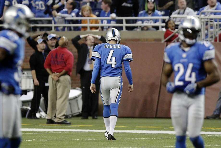 Detroit Lions kicker Jason Hanson (4) walks off the field after missing a 47-yard field goal attempt in overtime of an NFL football game against the Houston Texans, Thursday, Nov. 22, 2012, in Detroit. The Texans won 34-31. (AP Photo/Duane Burleson) Photo: Duane Burleson, Associated Press