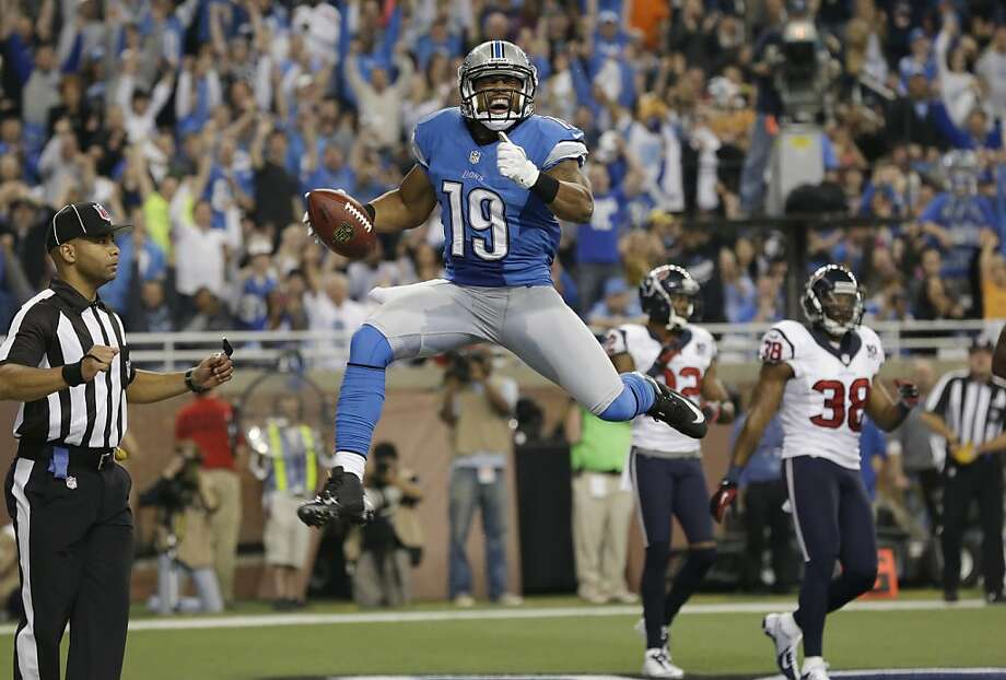 Detroit Lions receiver Mike Thomas celebrates his 5-yard touchdown reception during the second quarter of an NFL football game against the Houston Texans at Ford Field in Detroit, Thursday, Nov. 22, 2012. (AP Photo/Paul Sancya) Photo: Paul Sancya, Associated Press
