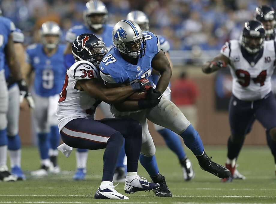 Houston Texans free safety Danieal Manning (38) strips the ball from Detroit Lions tight end Brandon Pettigrew (87) in overtime of an NFL football game in Detroit, Thursday, Nov. 22, 2012. Houston recovered the fumble. Houston won 34-31. (AP Photo/Paul Sancya) Photo: Paul Sancya, Associated Press