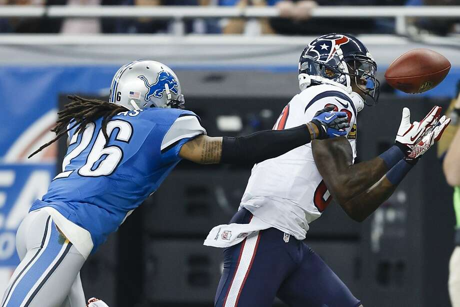 Houston Texans wide receiver Andre Johnson, right, makes a reception as Detroit Lions free safety Louis Delmas (26) defends in the first half of NFL football game at Ford Field in Detroit, Thursday, Nov. 22, 2012. (AP Photo/Rick Osentoski) Photo: Rick Osentoski, Associated Press